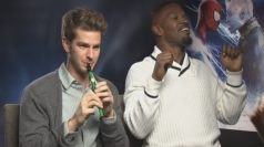 Andrew Garfield plays the flute while Jamie Foxx raps