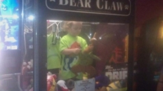 Three-year-old boy trapped in toy arcade machine