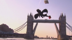 Giant dragon flies through London's Tower Bridge