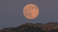 Supermoon lights up the sky around the world
