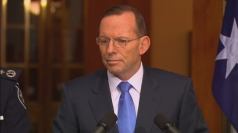 Australian PM sending unarmed police to MH17 crash site