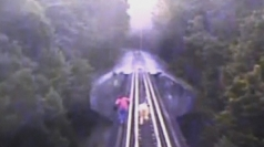 Two women narrowly escape death on railroad tracks