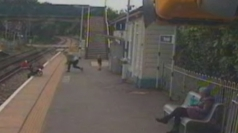 Terrifying moment pushchair rolls off train platform