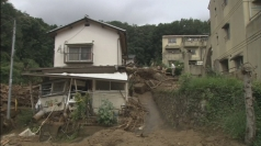 Eighteen dead and over a dozen missing in Japan landslide