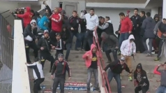 Football fans in Chile attack riot police