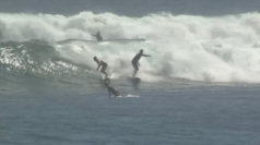 Surfers crowd Southern California beaches for giant waves