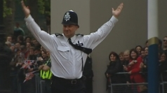 Policeman entertains the Royal crowds
