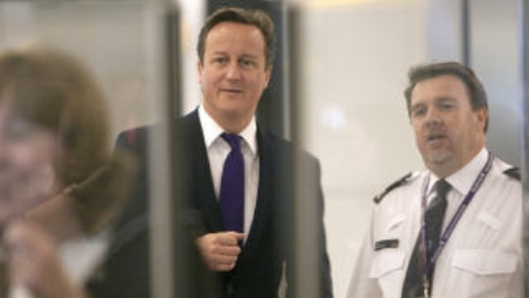 David Cameron watches immigration at work at Heathrow