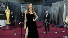 Angelina Jolie shows off her legs at the Oscars.