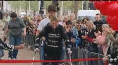 Claire Lomas crosses the finish line