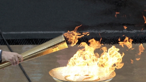 Olympic flame being lit in Athens.