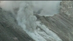 Costa Rica's Turrialba volcano spews smoke.