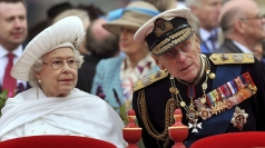 Prince Philip talks to The Queen during Sunday's flotilla.
