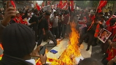 Protesters burn an effigy of the Sri Lankan president.