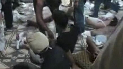 Bodies of victims lie in the village of Maarzaf in Syria.