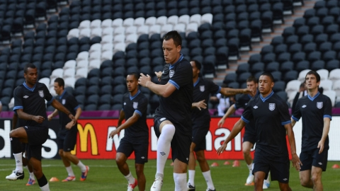 John Terry leads the England team during a warm up.