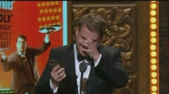 An emotional James Corden accepts his Tony Award