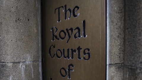 Royal Courts of Justice sign in London