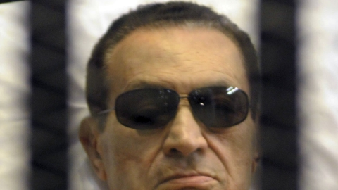 Hosni Mubarak lay on a stretcher at his trial.