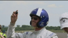 David Coulthard celebrating his fastest ever hole-in-one.