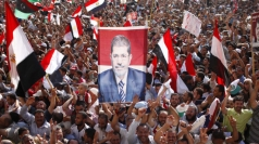 Supporters of Mr Morsy celebrate in Cairo.
