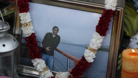 A picture of Anuj Bidve lies at the scene of his death.