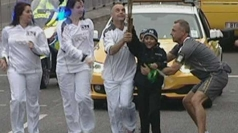 Children try to snatch Olympic torch