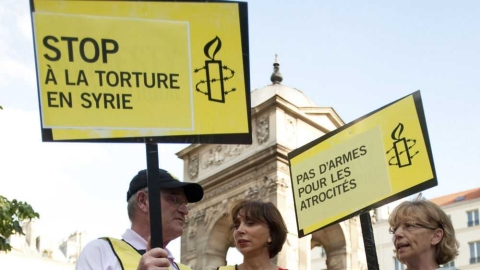 An Amnesty protest highlights the use of torture in Syria.
