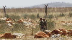 Turkish soldiers patrol the border with Syria.