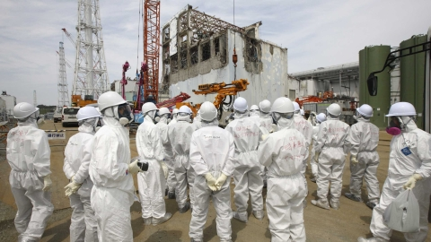 Members of the media outside Fukushima's damaged reactor