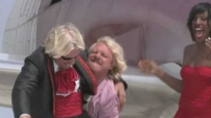 Keith Lemon attempts to lift Sir Richard Branson.