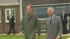 Prince Charles visits Prince William at work.