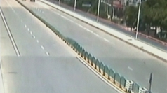 Road barrier in China collapses in domino effect