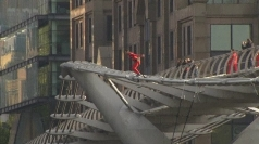 Gymnasts bungee-jump off London's Millennium Bridge
