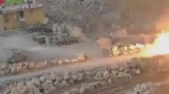 The truck appears to explode close to the assembled tanks.
