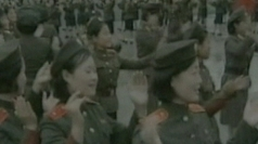 North Korean soldiers dance to celebrate Kim's promotion.