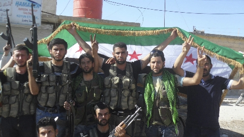 Members of the Free Syrian Army celebrate in Azzaz