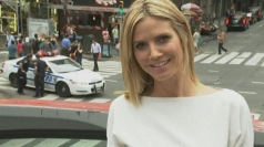 Smiling Heidi Klum talks Project Runway