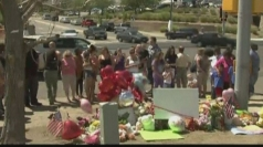 Denver Batman shootings: Flowers laid outside reopened mall