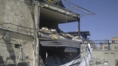 A damaged building in a district of Damascus.