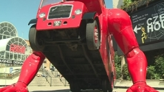 London bus does push ups in Islington for the Olympics