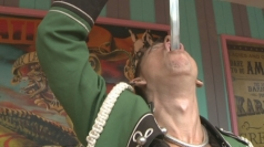 Freak show: Man swallows a sword and a fish hook