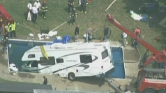 Motorhome plunges into swimming pool