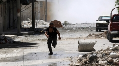 A man runs for cover in Syria