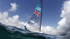 Great Britain's Ben Ainslie picks up gold.
