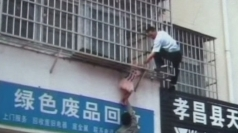 Girl gets head wedged in railings in China