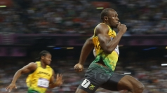 Usain completes his sprint double.