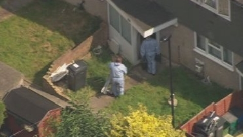 Forensic officers search the home of Tia Sharp's grandmother