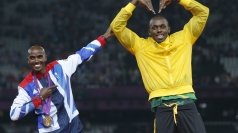 Mo Farah and Usain Bolt swap poses in the Stadium.