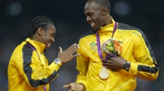 Usain Bolt and Yohan Blake celebrate their win.